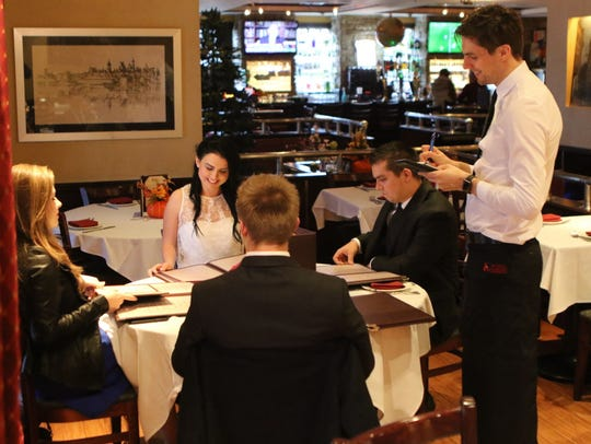 Waiter Marek Siek of Fair Lawn takes orders at Royal