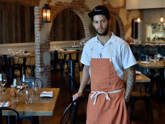 Chef Robbie Felice in the dining room of Viaggio Ristorante in Wayne .
