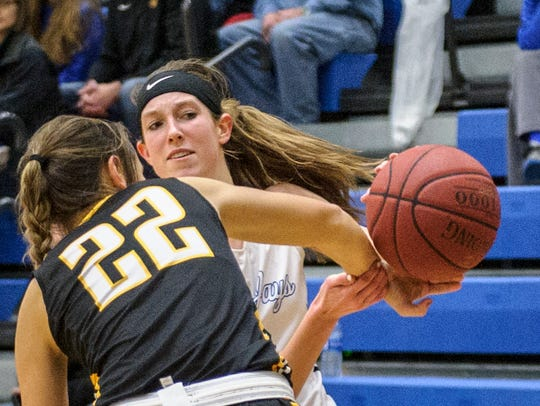 Bondurant Farrar's Taylor Berggren is fouled by Winterset's Ally Pickering in a game from 2017. Berggren had 9 points on three 3-pointers in a 50-47 loss to Winterset last week.