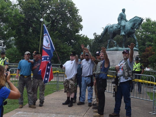 White supremacists give the Nazi salute in front of Gen. Robert E. Lee's statue in Emancipation Park in Charlottesville on Saturday, Aug. 12, 2017.