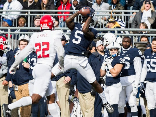 A Penn State receiver skies for a catch against Rutgers