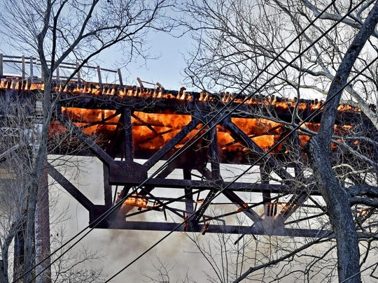 The railroad bridge over the Pequea Creek along River Road between Martic and Conestoga townships was in flames on Thursday.