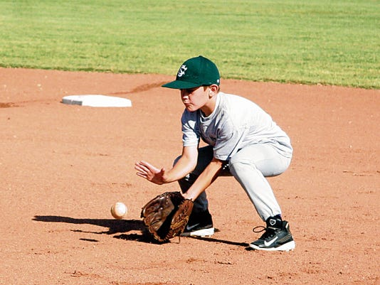 Matt Hollinshead — Current-Argus Sawyer Angelis retrieves the ground ball during the CHS baseball camp Tuesday, June 24, 2014 at Bob Forrest Youth Sports Complex. This year's camp starts at 9 a.m. next Tuesday.