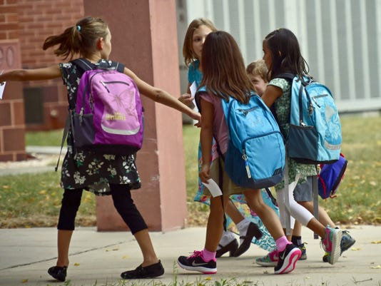 A group of children walk together at the start of classes Wednesday, August 19, 2015 at SOuth Hamilton Elementary School. Kids are back to school after summer break. Markell DeLoatch - Public Opinion