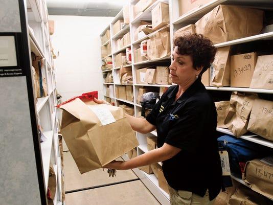 Eva Barron, civilian operation supervisor with the Farmington Police Department, on Friday shows how evidence is stored inside the main evidence room at the Farmington Police Department.