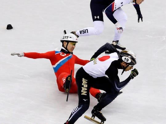 Jong Kwang Bom, of North Korea, crashes during their men's 500 meters short track speedskating heat in the Gangneung Ice Arena at the 2018 Winter Olympics in Gangneung, South Korea, Tuesday, Feb. 20, 2018. (AP Photo/Morry Gash)