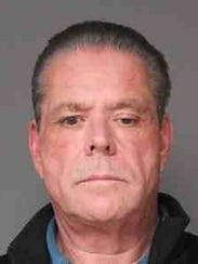 Mario Sasso, a former Yonkers police officer, is accused