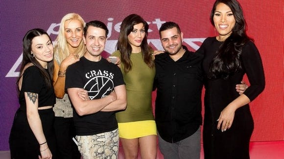 From left, Project Runway reality TV show contestants Helen Castillo, Uli Herzner Victor Luna, Irina Shabayeva, Michael Costello and Andy South pose for a photo after Fashion Week El Paseo – The Superstars of Project Runway fashion show held at El Paseo in Palm Desert on March 19, 2014. (Gerry Maceda/Special to The Desert Sun)