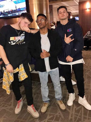 Pictured (from left) are longtime friends Andrew Bazzi, Brandon Harris and Hussein Youssef.