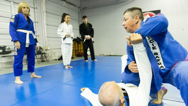 Sue Carter demonstrates a Brazilian jiu-jitsu move with her husband, David Carter, who is blind, on Saturday, Dec. 16, 2017 at Gracie Barra Las Cruces Brazilian Jiu-Jitsu and Self-Defense.