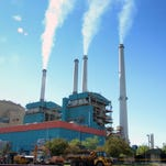 In this July 1, 2013, file photo smoke rises from the Colstrip Steam Electric Station, a coal burning power plant in Colstrip, Mont. Colstrip is one of the plants that would have been affected by President Obama's climate change plan to reduce carbon dioxide emissions.