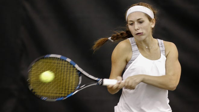 University School junior Riley Strauss gets her practice in at Mequon Elite tennis club on Tuesday.