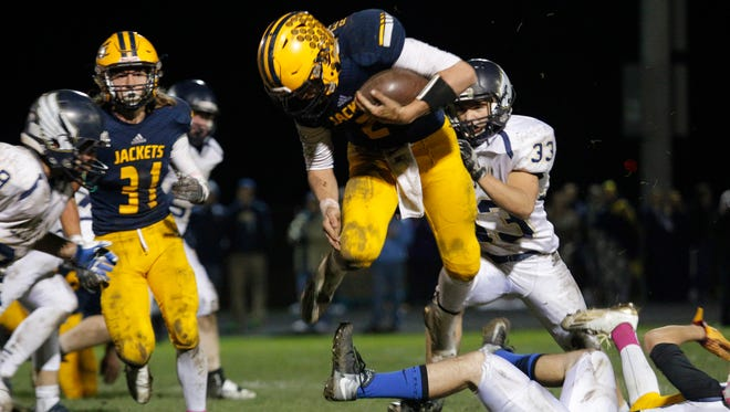 Quarterback Joey Bentley, center, and defending Division 6 state champion Ithaca could jump up to Division 5 for the state playoffs this season.