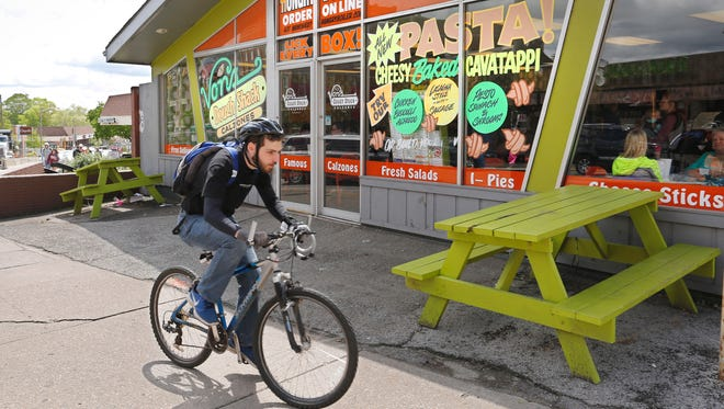 A cyclist pedals past Von's Dough Shack Tuesday, May 2, 2017, at 311 W. State Street in West Lafayette. Von's Dough Shack is closing.
