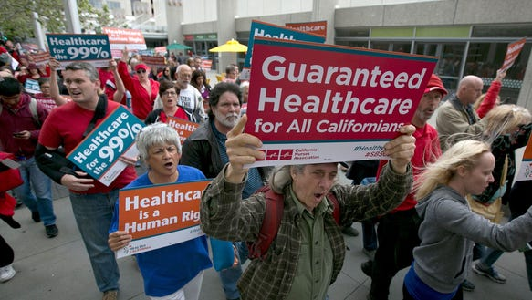 Supporters of single-payer health care march to the