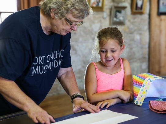 Volunteer Linda Weaver helps Veyva Oakley with crafts during Fort Concho Museum Day in July 2017. Volunteers help Fort Concho preserve our heritage in various capacities including participating living history events, maintenance and others.