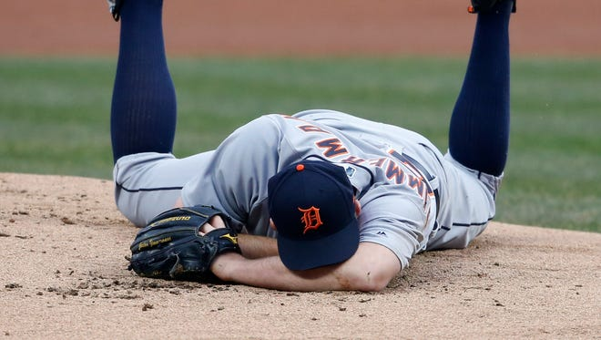 Detroit Tigers starting pitcher Jordan Zimmermann lays on the mound after getting hit by a ball off the bat of the Cleveland Indians' Jason Kipnis during the first inning Wednesday night.