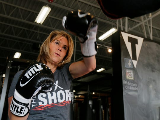 Ann Marie Earle, owner of Title Boxing Club in Holmdel, demonstrates different punches.