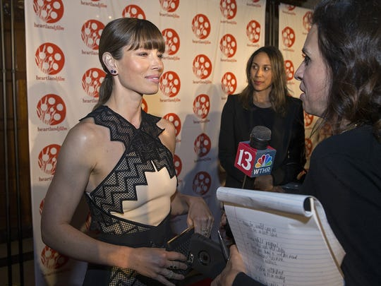 Actress Jessica Biel talks to media on the red carpet for opening night of the Heartland Film Festival at the Scottish Rite Cathedral on Oct. 20, 2016.