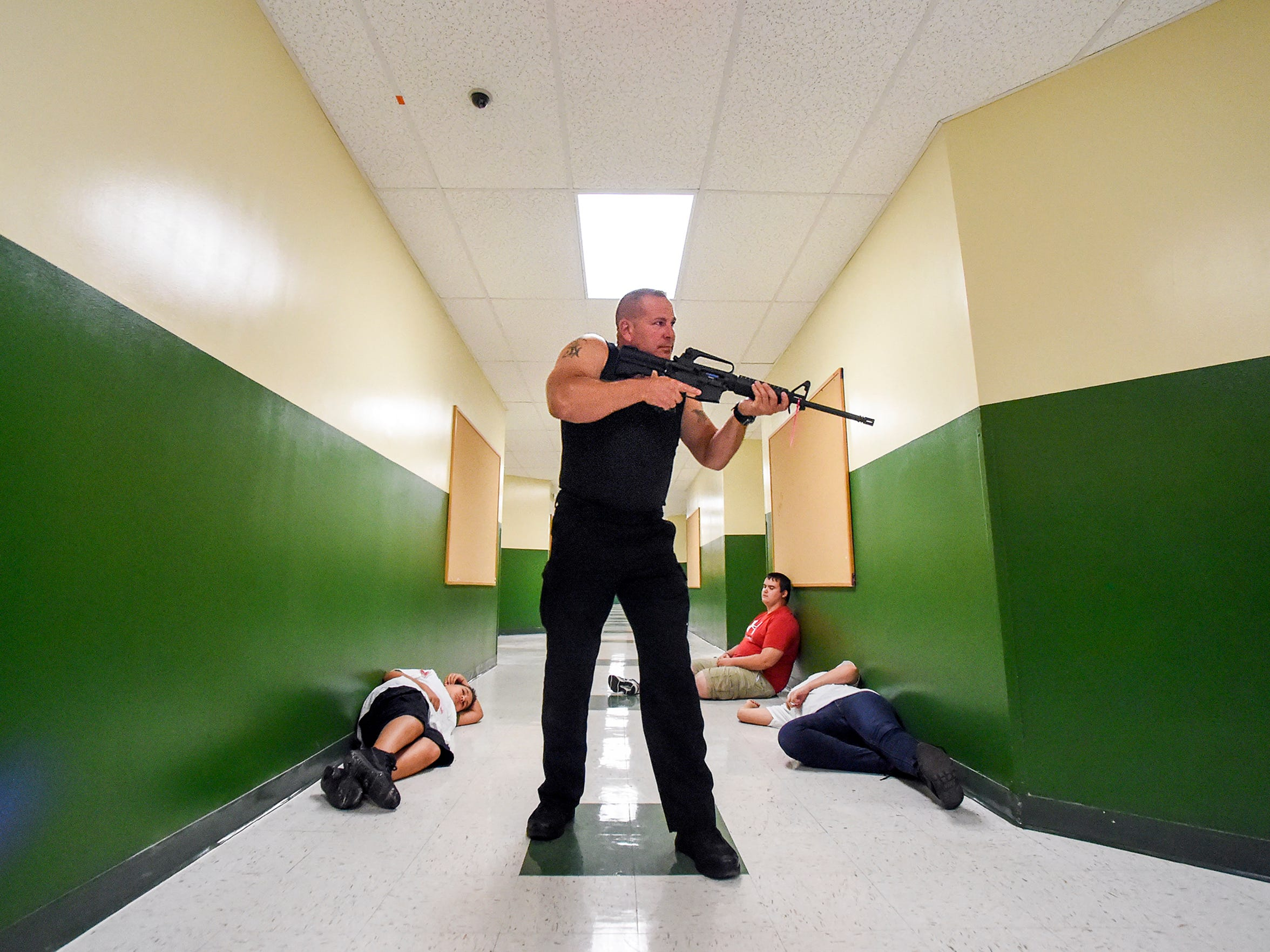 Port St. Lucie Police Officer Chris Kneidel plays the
