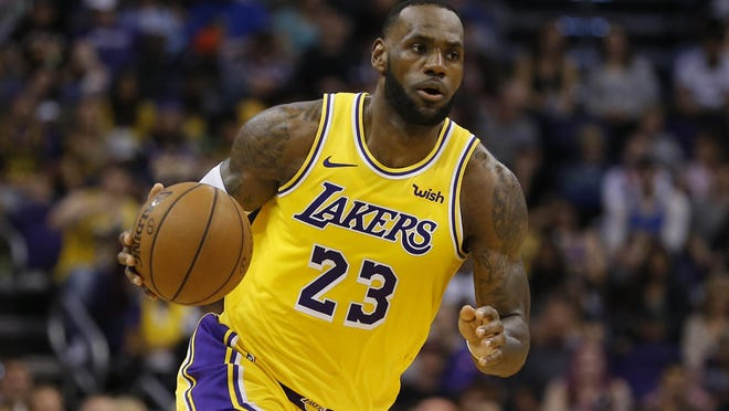 Los Angeles Lakers forward LeBron James (23) dribbles n the second half of a game on March 2, 2019 against the Phoenix Suns in Phoenix.