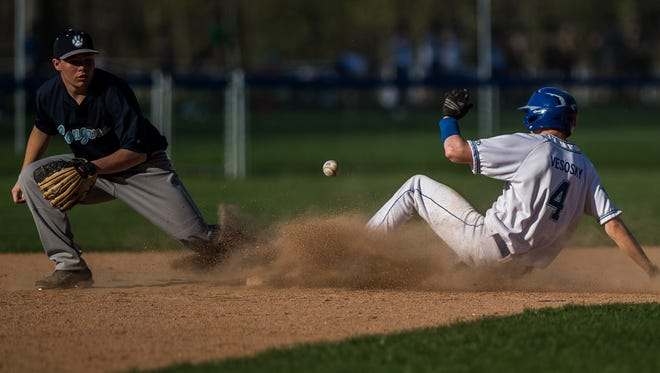 Colchester's #4 Tom Vesosky slides into second base before the throw can get to MMU's #21 Will Dix during their baseball game Wednesday night, May 9, 2018, against Colchester. MMU won, 8-4.