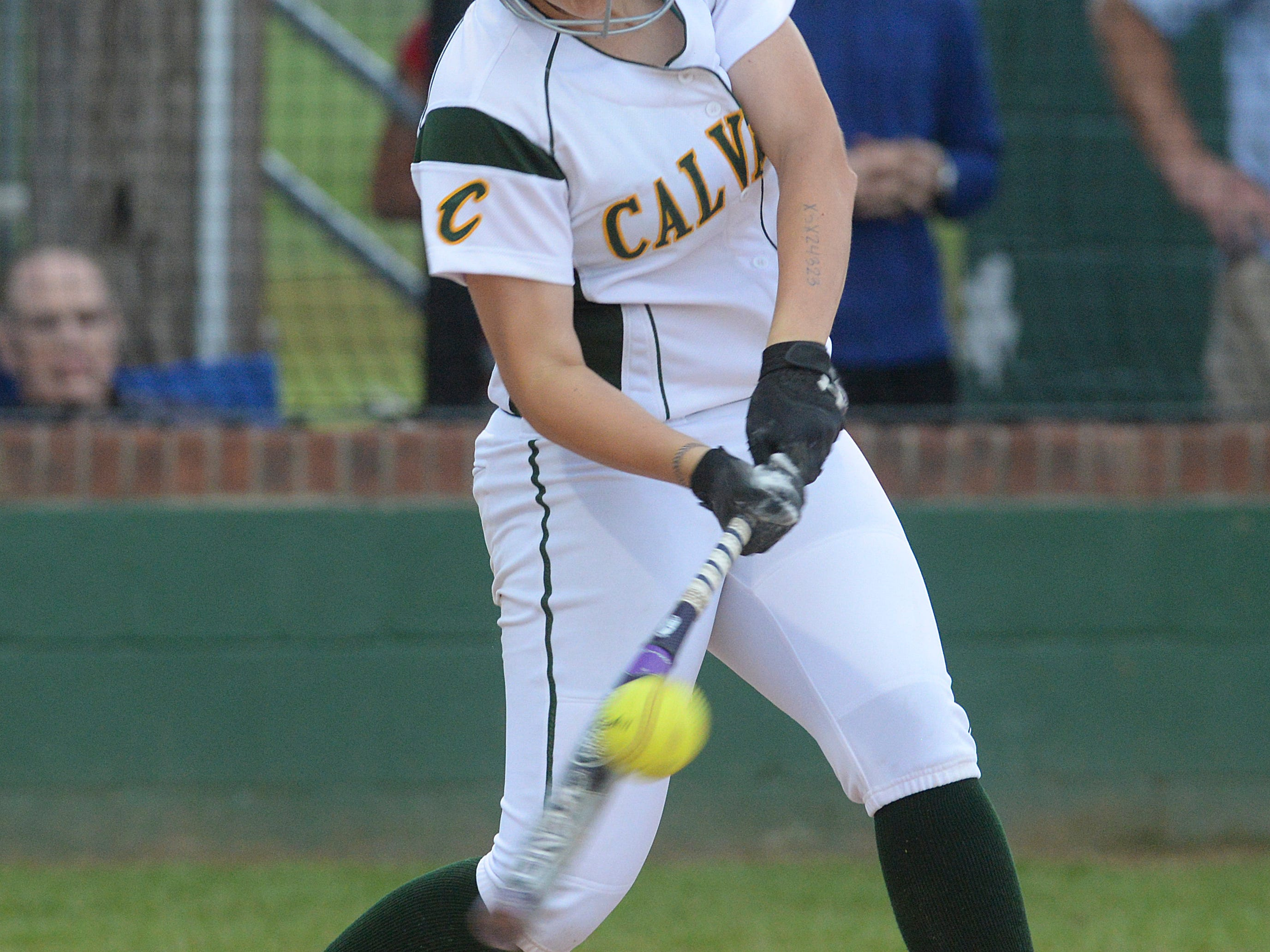 Calvary's Jordan Fielder hits a shoot to right field that scores Maggie Woodle and wins the game against Sterlington in their Class 2A softball playoff game.