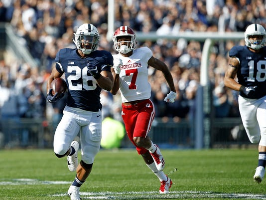 Penn State's Saquon Barkley (26) takes the opening kick off 98 yards for a touchdown against Indiana during the first half of an NCAA college football game in State College, Pa., Saturday, Sept. 30, 2017. (AP Photo/Chris Knight)