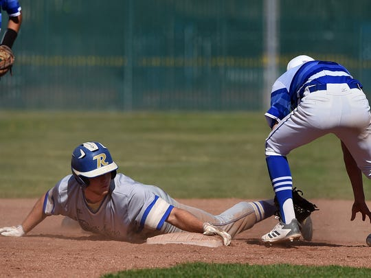 Reed's Brandon Biggs slides safely into second as McQueen's Logan Anderson reaches for a bobbled ball  at McQueen on April 24.
