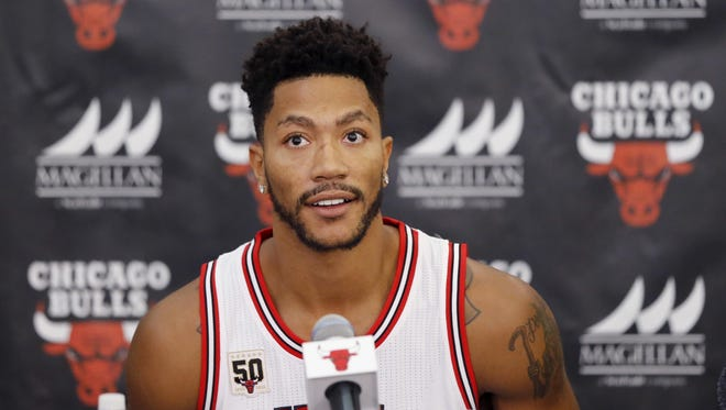 In this Sept. 28, 2015, file photo, Derrick Rose sits down for a news conference in Chicago.