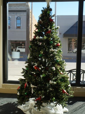 A Christmas tree honoring the memories of loved ones stands in the lobby of the Jackie Creamer Dance Studio, 1003 Main St. The tree, erected for the first time this year by the Center for Life Experience, holds ornaments honoring the lives of adult loved ones.