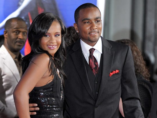 "In this 2012 photo, Bobbi Kristina Brown, left, and husband Nick Gordon attend the premiere of ""Sparkle"" in Los Angeles. The daughter of the late singer Whitney Houston is in a medically induced coma."