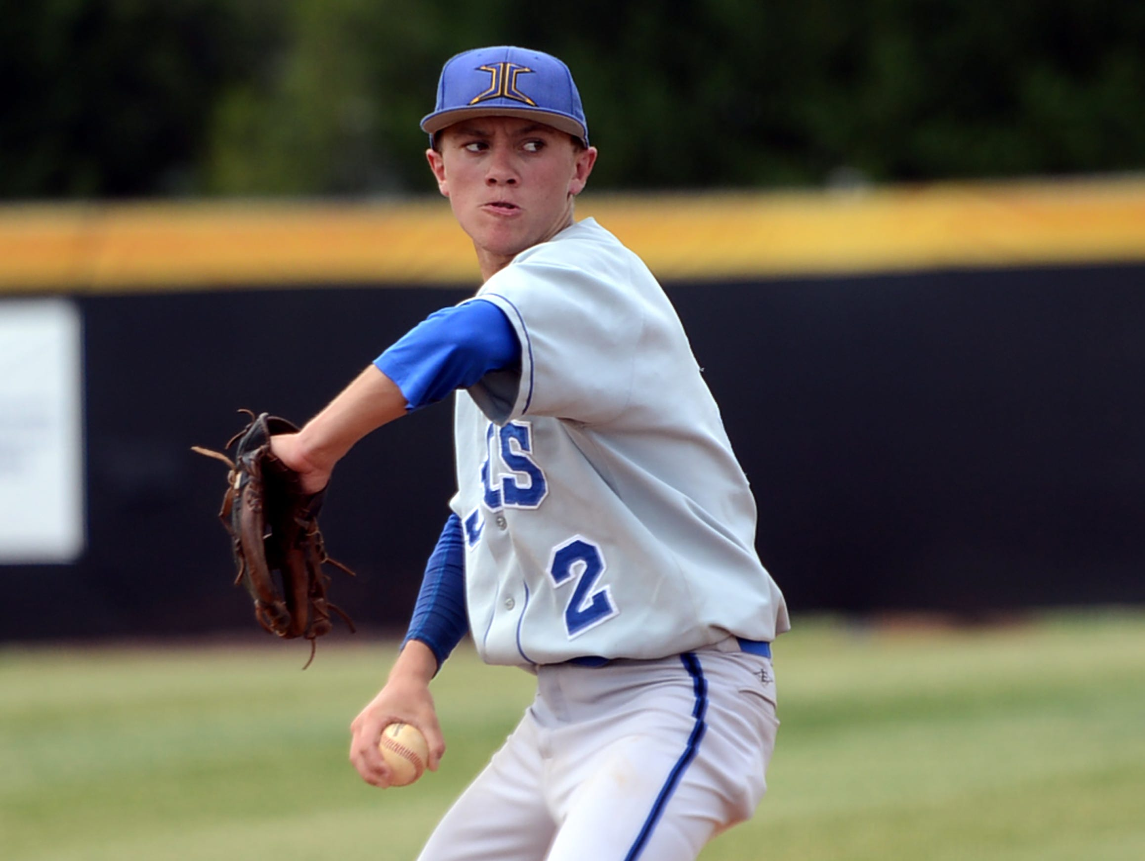 Jackson Christian's Hunter Higdon winds back for a pitch during game one of their doubleheader against Goodpasture Christian School on Thursday, May 22, 2014, during the Class A state tournament.