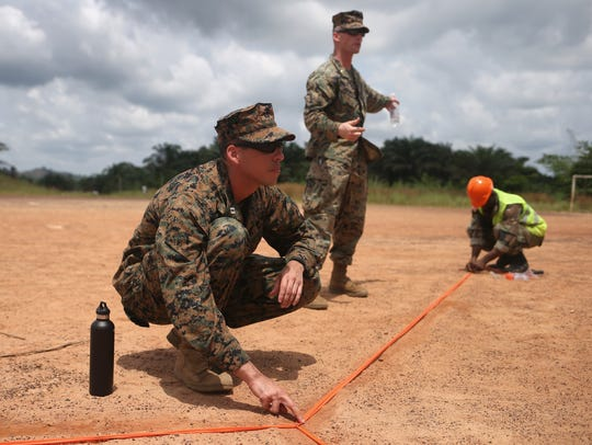 Marines and Liberian troops set up a landing zone at