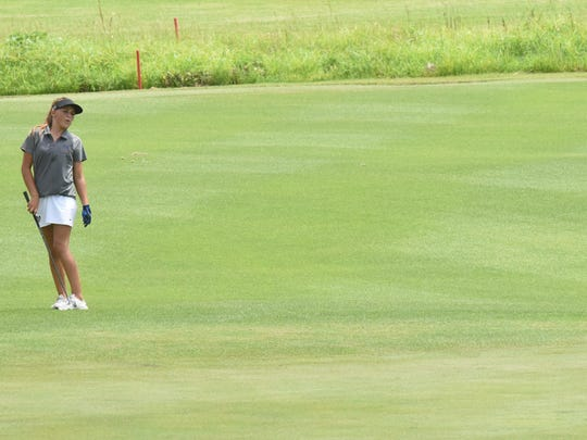 Mountain Home's Sydney Czanstkowski reacts to her chip just missing the cup on the sixth hole during action against Searcy on Wednesday at Big Creek Golf & Country Club.