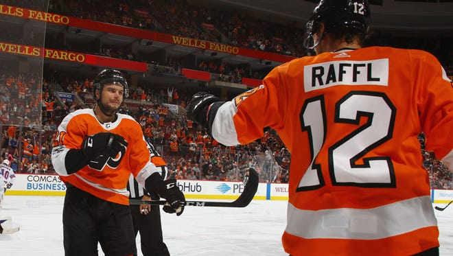 Scott Laughton, left, notched a goal Tuesday night and has done enough to earn a spot in the NHL.