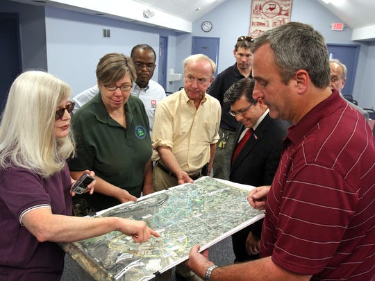 Rep. Rodney Frelinghuysen (NJ-11) conducts his annual tour of Superfund sites in the 11th Congressional District of New Jersey, with a stop in Rockaway. He and other officials look over a map of the area, shown by EPA sit manager Brian Quinn, right. The others from left include Councilwoman Joyce Kanigel, EPA Regional II Administrator Judith Enck, Frelinghuysen, and Assemblyman Anthony Bucco.