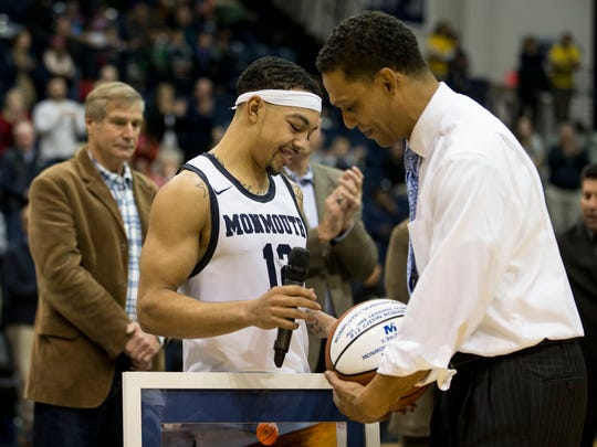 Monmouth's Justin Robinson and head coach King Rice during the postgame celebration to honor Robinson's scoring record.