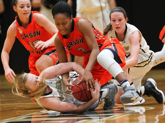 Anderson senior guard Heather Jankowy (1), left, controls a loose ball near Carson-Newman freshman guard Briana Smith (2), middle, and teammate Madison Baggett (23), right, in the third quarter Wednesday in the Abney Athletic Center at Anderson University.
