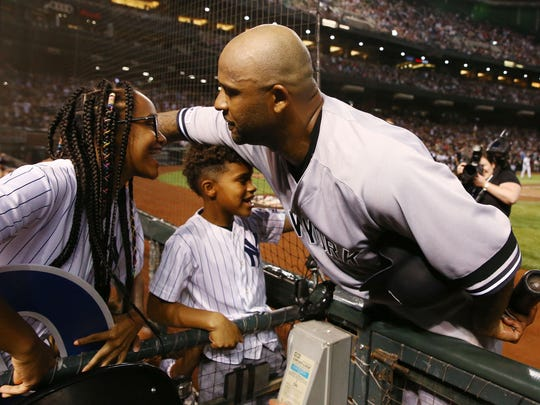 New York Yankees pitcher CC Sabathia celebrates with his children after striking-out Arizona Diamondbacks John Ryan Murphy in the second inning on Apr. 30, 2019 at Chase Field in Phoenix, Ariz. With three strikeouts in the second inning, CC Sabathia became the 17th person to get 3,000-strikeouts.