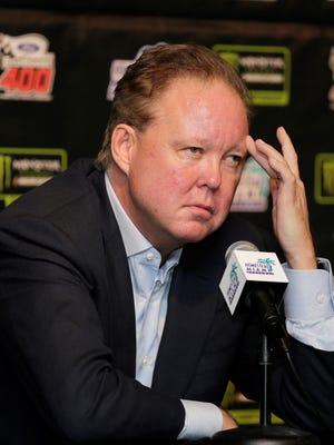 FILE - In this Nov. 19, 2017, file photo, Brian France, NASCAR Chairman, ponders a question during a news conference at Homestead-Miami Speedway in Homestead, Fla. NASCAR chairman Brian France has been arrested in New York's Hamptons for driving while intoxicated and criminal possession of oxycodone. France was arrested at 7:30 p.m. Sunday, Aug. 5, 2018, and held overnight. He was arraigned Monday at Sag Harbor Village Justice Court and released. (AP Photo/Terry Renna, File)