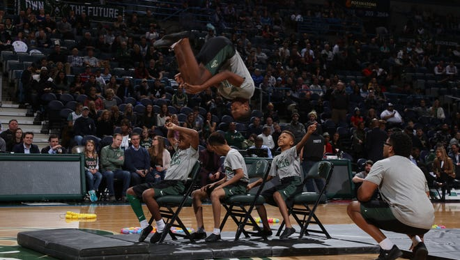 The Milwaukee Flyers appear during a game in the 2018 Milwaukee Bucks season. The Bucks are holding tryouts for local performers who will appear during breaks in games in the upcoming season at their new arena.