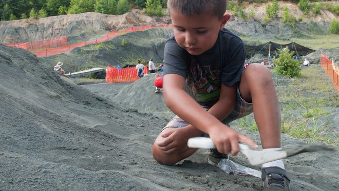 Rowan Summer camp Student, Andrew Ellison,  age 6, from Mantua, N.J. digs for Dinosaurus or fossils at the   Rowan's fossil park in Mantua, N.J.