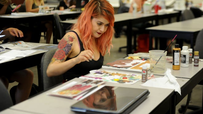 Andrea Sanchez, of Santa Paula, paints in an art and design class at CSU Channel Islands in Camarillo. She is a psychology major with an art minor.