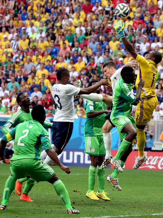 Nigeria's goalkeeper Vincent Enyeama fails to gather a cross from which France's Paul Pogba scored the opening goal during the World Cup round of 16 soccer match between France and Nigeria at the Estadio Nacional in Brasilia, Brazil, Monday, June 30, 2014. (AP Photo/David Vincent)