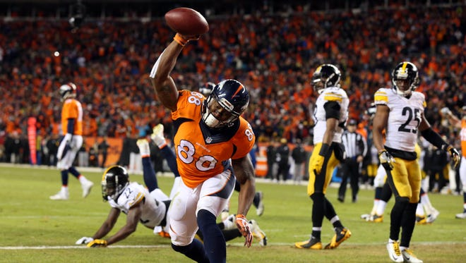 Denver Broncos wide receiver Demaryius Thomas (88) celebrates after scoring on a two-point conversion against the Pittsburgh Steelers during the fourth quarter of the AFC Divisional round playoff game at Sports Authority Field at Mile High.