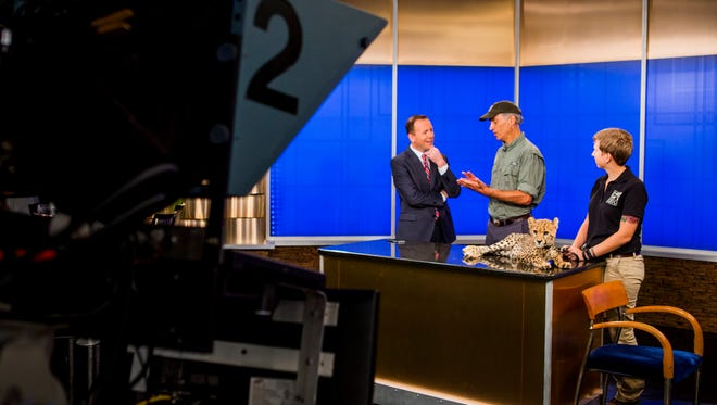 In this 2016 file photo, Fox19 Meteorologist Frank Marzullo, left, speaks with a guest from the Cincinnati Zoo & Botanical Garden.
