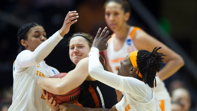 Tennessee's Evina Westbrook, left, and Rennia Davis surround Oregon State's Mikayla Pivec on the final play of the game in the second round of the NCAA tournament on March 18.
