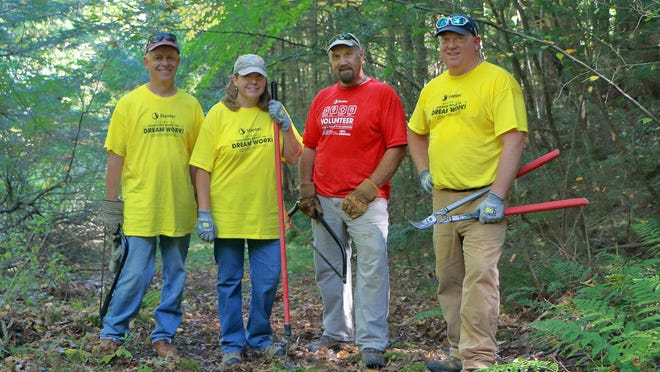 Lake Champlain Land Trust volunteers Rick Bryant, Marcy King, Steve Magoon, Peter Armata at the  family-friendly Upper La Platte River Natural Area in Shelburne.