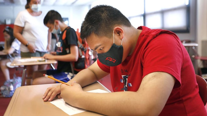 Student Edwin Astronomo, 15, works in class at North Quincy High while wearing a mask on Monday, July 20, 2020. Greg Derr/The Patriot Ledger